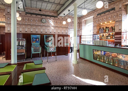 Retro-looking interiors and formica pastel furniture at Bar Luce, Wes Anderson-inspired bar and cafe in the Fondazione Prada district of Milan, Italy - Stock Image