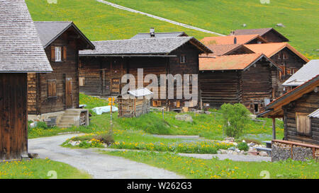 Old timber chalets in Obermutten, Switzerland. - Stock Image