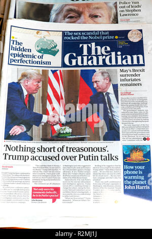 'Nothing short of treasonous' Trump accused over Putin talks newspaper headline in The Guardian London England UK 17 July 2018 - Stock Image