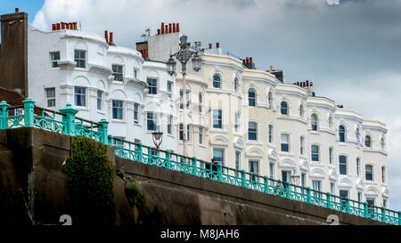 Row of classic grand terraced Victorian seafront homes overlooking Madeira Drive in Brighton - Stock Image