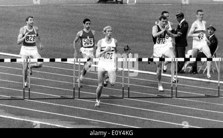 Oct 18, 1968; Mexico City, MEXICO; British runner DAVID HEMERY (402), seen on his way to victory and a gold medal in the men's 400 meters hurdles final during the Olympic Games. - Stock Image