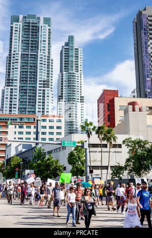 Miami Florida demonstration demonstrating protest protesting Families Belong Together Free Children illegal immigration Mexican border family separati - Stock Image