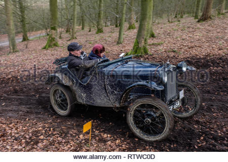 The Vintage Sports Car Club (VSCC) annual John Harris Trial for vintage pre-war cars in the Derbyshire countryside around Ashover village. One of challenges faced by competitors was on hills at Carlton Lees. In a VSCC Trial competitors score points depending how far they travel up the hill. Competitors must carry passengers who are called 'Bouncers'. Bouncing gives the car more grip and helps it to travel further up the hill. - Stock Image