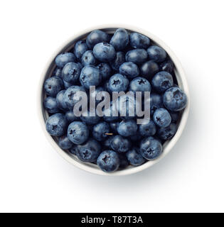 Top view of fresh ripe blueberries in bowl isolated on white - Stock Image