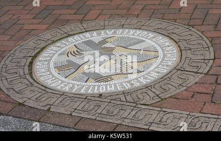 Mosaic plaque on the Millennium Promenade commemorating 'Gunpowder Yellowed skin of women who worked at Priddys Hard'. Portsmouth, Hampshire, UK - Stock Image