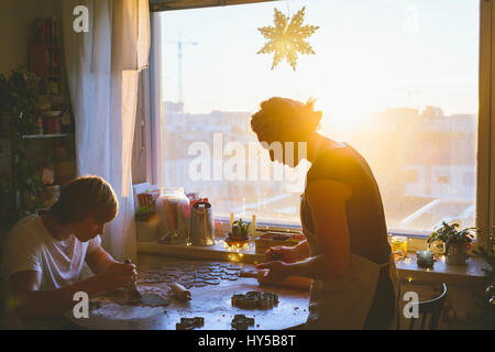 Finland, Helsinki, Couple preparing christmas cookies - Stock Image