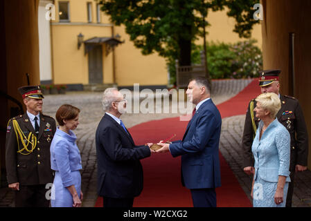 RIGA, LATVIA. 8th of July 2019. Former President of Latvia Raimonds Vejonis (R) giving  Symbolic handover of the keys of the Riga Castle  to Newly Elected President of Latvia Egils Levits (L) accompanied by First Ladies of Latvia Iveta Vejone (First from Right) and Andra Levite (From Left) Credit: Gints Ivuskans/Alamy Live News - Stock Image