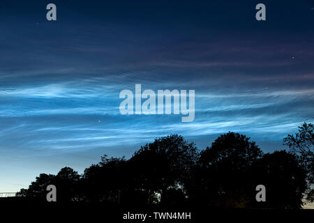 Teesdale, County Durham, UK.  22nd June 2019. UK Weather.  Beautiful noctilucent clouds light up the sky above Teesdale in North East England. These rare luminous clouds form due to ice crystals in the Earth's upper atmosphere and are only visible during astronomical twilight in the summer months. Credit: David Forster/Alamy Live News - Stock Image