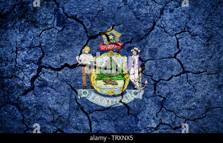 Flag of the state of Maine on dry earth ground texture background - Stock Image