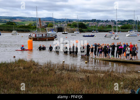 Topsham, UK. 19th August, 2018. Swimmers take part in the annual Topsham to Turf Ferryman's Swim along the River Exe in Devon, UK. Credit: VAmbrosini/Amaly Live News. - Stock Image