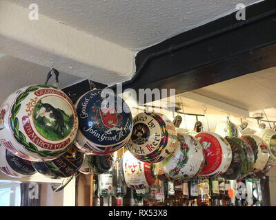 Painted balls from previous years' play in Ashbourne Shrovetide Football game hang in the bar at The Wheel Inn, Compton, Ashbourne, prior to 2019 game - Stock Image