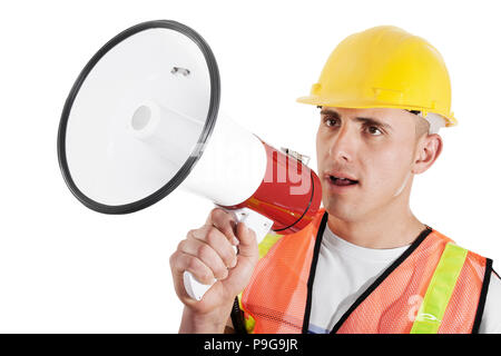Construction foreman giving orders on bullhorn isolated on white background - Stock Image