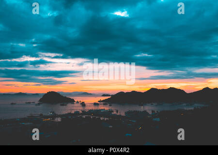 View of the Labuan Bajo port at dusk, island of Flores (East Nusa Tenggara), Indonesia. - Stock Image