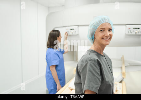 Portrait Of Happy Mature Woman Smiling As Patient In Clinic - Stock Image