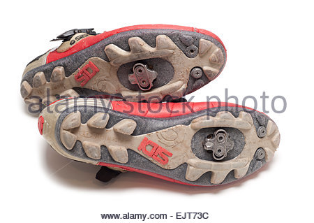 The bottom sole of a pair of 10 year old Sidi mens dominator mountain biking cycling shoes.  With Shimano Clipless - Stock Image