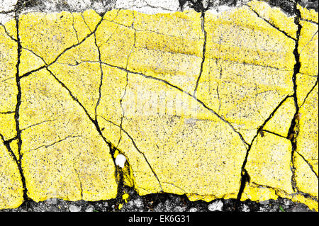 Part of a yellow road marking as an asbtract image - Stock Image