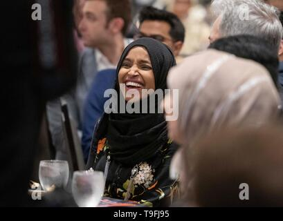 Congresswoman Ilhan Omar of Minnesota's 5th Congressional District laughs during a speaker's remarks at the annual city-wide iftar dinner in Austin, Texas, in honor of the 14th day of Ramadan. Omar was the event's main speaker. - Stock Image