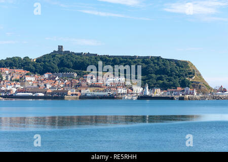 Harbour and castle view from South Beach, Scarborough, North Yorkshire, England, United Kingdom - Stock Image
