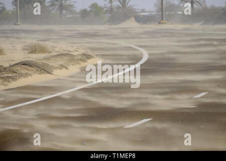 Sand storm sweeping across the road, Abu Dhabi, UAE - Stock Image