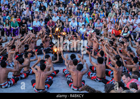 Local Balinese people  performing traditional Fire Dance outside during an evening ceremony. Bali Indonesia - Stock Image