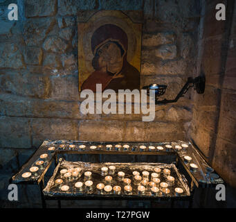 Lindisfarne or Holy Island, Northumberland coast south of Berwick-on-Tweed, England. Parish church of St Mary the Virgin. Votive candles. - Stock Image
