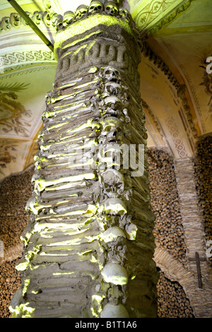 Column decorated with human remains in the Chapel of Bones, Capela dos Ossos, Church of St Francis, Evora, Alentejo, - Stock Image