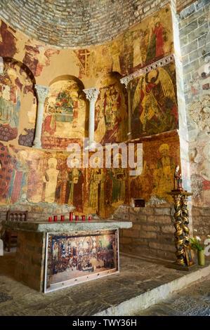 Altar, mural paintings and virgin sculpture of the XI century romanesque church of Santa María de Iguácel (Larrosa, Garcipollera, Huesca,Aragón,Spain) - Stock Image