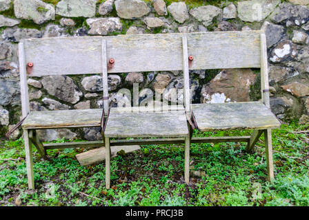Weathered wooden folding chairs outside. - Stock Image