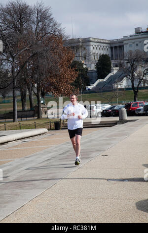 Jogger running around the reflection pool  near the Cpitol building in Washington DC - Stock Image