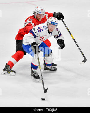 Bratislava, Slovakia. 15th May, 2019. Mathis Olimb (NOR), front, Gaetan Haas (SWE) in action during the match between Switzerland and Norway within the 2019 IIHF World Championship in Bratislava, Slovakia, on May 15, 2019. Credit: Vit Simanek/CTK Photo/Alamy Live News - Stock Image