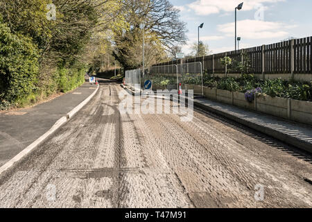 Presteigne, Powys, Wales, UK. Road surface after the old tarmac has been removed by a cold planer, before new tarmac or asphalt is laid - Stock Image