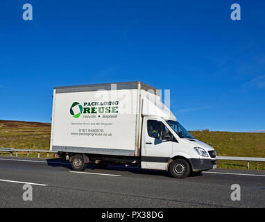 Packaging Reuse & Disposal Services Limited Van. M6 motorway Southbound carriageway, Shap, Cumbria, England, United Kingdom, Europe. - Stock Image