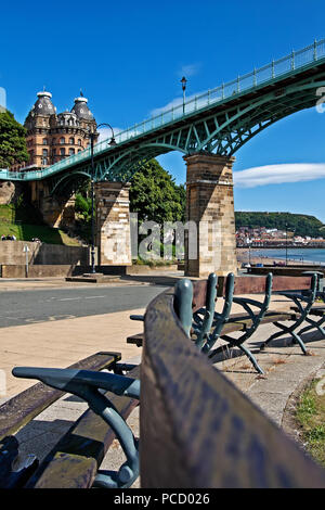 The Grand Hotel sits at the end of Scarborough's Spa Bridge, overlooking the Castle headland and South Bay. - Stock Image
