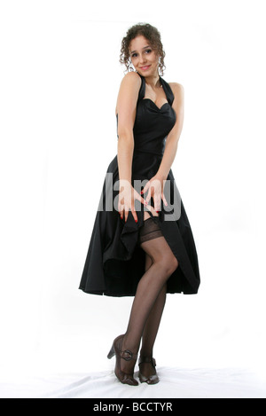 Dark Haired Portuguese Woman in a Black Dress, White Background - Stock Image