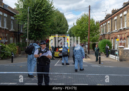 London, United Kingdom. 15 August 2018. A murder investigation has been launched in Wandsworth after a woman was fatally stabbed. Police were called on Wednesday, 15 August at 12:38BST to a report of a stabbing at a residential address in Grayshott Road, SW11. A woman, believed to be aged in her 30s was found with a stab injury. She was pronounced dead at the scene at 13:41BST. Credit: Peter Manning/Alamy Live News - Stock Image
