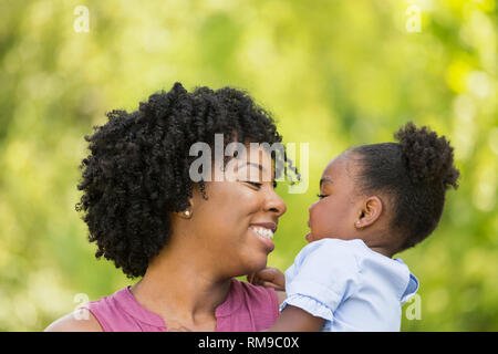 African American mother parenting his daughter. - Stock Image