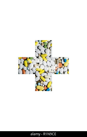 colored pills for the treatment of diseases and drug addiction in the form of a medical cross - Stock Image