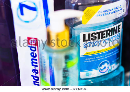 Poznan, Poland - November 18, 2018: Listerine Stay White blue mouth wash in a plastic bottle in a bathroom in soft focus. - Stock Image