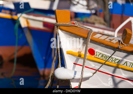 Traditional fishing boats in the harbour at Loggos. - Stock Image