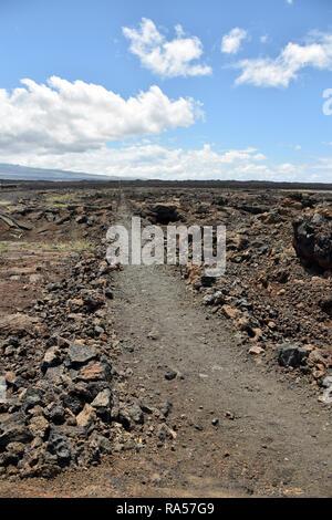 Hiking trail through lava field on the Big Island Hawaii - Stock Image