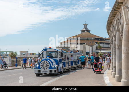 Bournemouth, UK. 11th June 2018. Tourists queue for the land train on Bournemouth beach and seafront. Credit: Thomas Faull/Alamy Live News - Stock Image