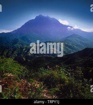 Gunung (mount) Kinabalu, granite massif rising to 4101 metres, Kinabalu National Park, Sabah, East Malaysia - Stock Image