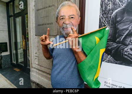 London, UK. 13th August 2018.  Brazilians protest outside the Brazilian embassy calling for the release of Luiz Inacio Lula da Silva, a former trade union leader who was President of Brazil from 2003-11 to enable him to stand for election again in October.  Many wore Lula masks. Credit: Peter Marshall/Alamy Live News - Stock Image
