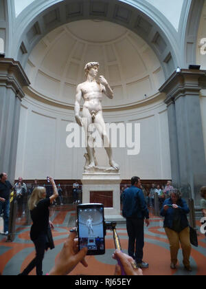 David by Michelangelo is photographed by a tourist - Stock Image