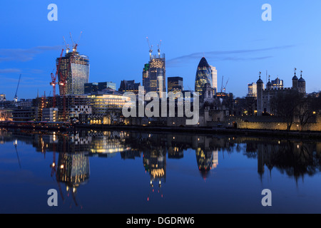 City of London at sunrise showing Walkie Talkie and The Pinnacle skyscraper under construction - Stock Image
