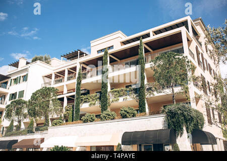 Beautiful view of a residential building with many windows and balconies with plants in Tivat in Montenegro. - Stock Image