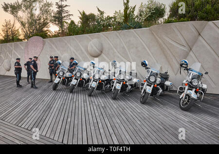 New York, USA - July 02, 2018: NYPD Highway Patrol officers and motorcycles on the Coney Island beach boardwalk at sunset. - Stock Image