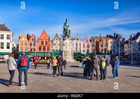 25 September 2018: Bruges, Belgium - Tourists in the Market Square on a sunny afternoon. - Stock Image