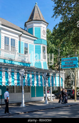 Outside view of Commander's Palace Restaurant building, famous Creole cuisine restaurant, New Orleans Garden District, New Orleans, Louisiana, LA, USA - Stock Image
