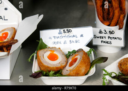 Scotch eggs with pork and sage for sale at Borough Market in London UK. KATHY DEWITT - Stock Image